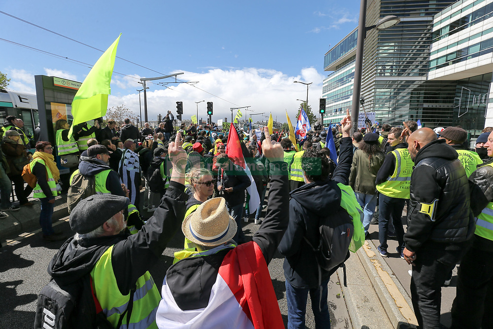 April 27, 2019 - Paris, Ile-de-France, France - Protesters put their middle finger up against journalists in front of the headquarters of French TV group France Television during a rally against medias in the French capital Paris, on the 24th consecutive Saturday of demonstrations called by the 'Yellow Vest' (gilets jaunes) anti-government movement on April 27, 2019. Demonstrators are expected to protest on French city streets again for a 24th consecutive week of nationwide protest against the French President's policies and his top-down style of governing, high cost of living, government tax reforms and for more ''social and economic justice.'' France's finance minister promised on April 26, 2019, that some 15 million households would benefit from tax cuts announced by President Emmanuel Macron, but the move did little to calm tempers among ''yellow vest'' protesters. (Credit Image: © Michel Stoupak/NurPhoto via ZUMA Press)