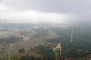 Nederland, Limburg, Budel, 24-10-2013;  Loozerheide in de mist gezien naar de Zinkfabriek (Nyrstar Budel).<br /> Moorland in the mist, near zinc factory (Nyrstar Budel).<br /> luchtfoto (toeslag op standaard tarieven);<br /> aerial photo (additional fee required);<br /> copyright foto/photo Siebe Swart.