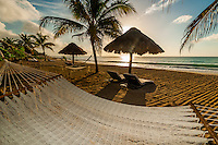 Hammock and palapas on the beach at Le Reve Hotel, Riviera Maya, Quintana Roo, Mexico