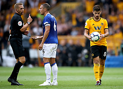 Referee Craig Pawson shows a red card to Everton's Phil Jagielka after a tackle on Wolverhampton Wanderers' Diogo Jota (not in picture) as Ruben Neves (right) lines up to take a free kick during the Premier League match at Molineux, Wolverhampton.