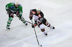 Raffaele Intranuovo vs Mitja Robar at 39th Round of EBEL League ice hockey match between HDD Tilia Olimpija and HK Acroni Jesenice, on December 30, 2008, in Arena Tivoli, Ljubljana, Slovenia. Tilia Olimpija won 4:3. (Photo by Vid Ponikvar / SportIda).