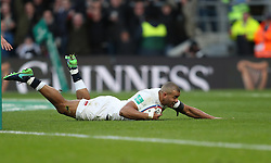 England's Jonathan Joseph scores his side's first try during the Autumn International match at Twickenham Stadium, London.