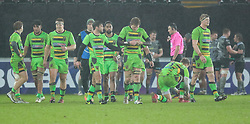 Northampton Saints players walk away dejected after the match<br /> <br /> Photographer Simon King/Replay Images<br /> <br /> EPCR Champions Cup Round 4 - Ospreys v Northampton Saints - Sunday 17th December 2017 - Parc y Scarlets - Llanelli<br /> <br /> World Copyright © 2017 Replay Images. All rights reserved. info@replayimages.co.uk - www.replayimages.co.uk