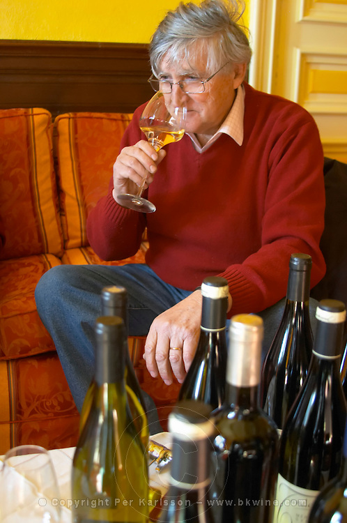 Bernard Jany Chateau la Condamine Bertrand. Pezenas region. Languedoc. Owner winemaker. Tasting wine. France. Europe. Bottle. Wine glass.