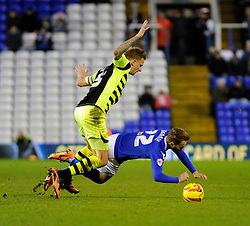 Birmingham City's Andrew Shinnie goes under after a challenge from Yeovil Town's Byron Webster - Photo mandatory by-line: Dougie Allward/JMP - Tel: Mobile: 07966 386802 18/01/2014 - SPORT - FOOTBALL - St Andrew's Stadium - Birmingham - Birmingham City v Yeovil Town - Sky Bet Championship