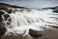 Urriðafoss waterfall in river Þjórsá, South Iceland. Landsvirkjun, the energy company owned by the Icelandic State, is planning to build hydropower stations on the lower part of Þjórsár river, at Urriðafoss and Núpur..The proposed Urriðafoss Power Plant is expected to have a capacity of approximately 125 MW and a power-generating capacity of 930 GWh per year. The powerhouse will be underground and a tunnel leading from the powerhouse will open out into Þjórsá river below Urriðafoss waterfall. The waterfall is expected to disappear.