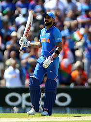 India's Virat Kohli celebrates reaching his half century during the ICC Cricket World Cup group stage match at the Hampshire Bowl, Southampton.