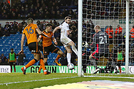 Wolverhampton Wanderers defender Danny Batth  and Leeds United midfielder Stuart Dallas contest an aerial ball during the EFL Sky Bet Championship match between Leeds United and Wolverhampton Wanderers at Elland Road, Leeds, England on 7 March 2018. Picture by Paul Thompson.