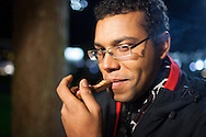 December 6, 2012. Seattle, Washington. Washington and Colorado became the first states to vote to decriminalize and regulate the possession of an ounce or less of marijuana by adults over 21. Pictured at a 'Stash Mob' gathering in Seattle is Randell Turner from Tenby in Wales, smoking marijuana in public.....Photo © John Chapple / www.JohnChapple.com