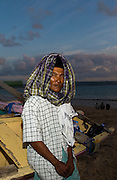 A fishermen rests next to his boat after a day of fishing offshore Bali, Indonesia