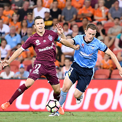 BRISBANE, AUSTRALIA - FEBRUARY 3: Matt McKay of the Roar and Brandon O'Neill of Sydney compete for the ball during the round 18 Hyundai A-League match between the Brisbane Roar and Sydney FC at Suncorp Stadium on February 3, 2017 in Brisbane, Australia. (Photo by Patrick Kearney/Brisbane Roar)
