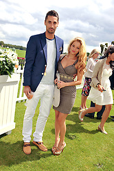 HUGO TAYLOR and NATALIE JOEL at the Cartier Queen's Cup Polo Final, Guards Polo Club, Windsor Great Park, Berkshire, on 17th June 2012.