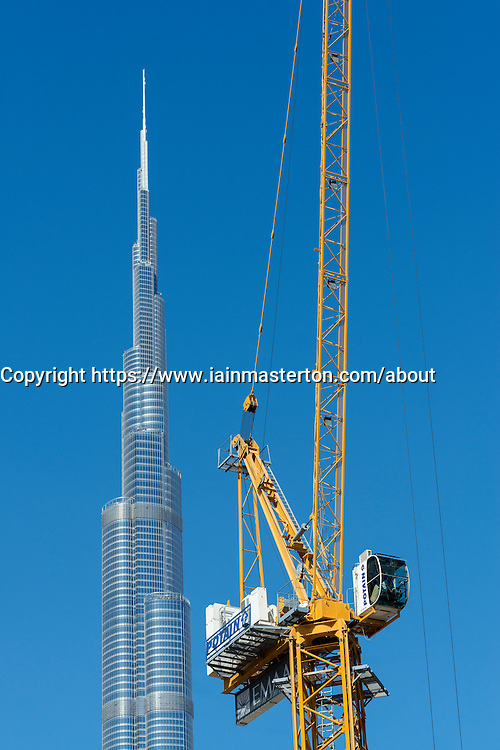 Burj Khalifa and crane at construction site in Dubai United Arab Emirates