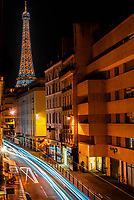 Blurred traffic on rue St. Dominque with the Eiffel Tower behind, Paris, France. It is the world famous wrought-iron lattice tower that is the most famous landmark of Paris, France.