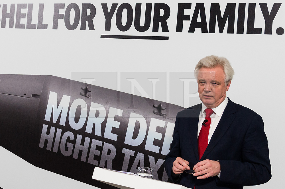 "© Licensed to London News Pictures. 03/05/2017. London, UK.  DAVID DAVIES Secretary of State for Exiting the European Union speaks at a General Election Campaign event featuring a poster of Labour party leader JEREMY CORBYN with the slogan ""More debt, higher tax."" Photo credit: Ray Tang/LNP"