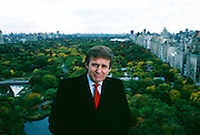 Donald Trump on top of the Plaza Hotel he owns with New York City's Central Park in the background.