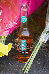 © Licensed to London News Pictures . 12/07/2013 . Manchester , UK . Bottle of WKD .  Flowers and tributes at the scene on 5 Beard Road , Gorton , Manchester , for Jordan Begley , who died on Wednesday evening (10th July 2013) after a taser was used on him by police . Police reported the incident , which has been referred to the IPCC , occurred at 20:15 after they responded to a disturbance involving a man with a knife . Photo credit : Joel Goodman/LNP