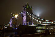 London's tallest skyscraper, the Shard, beams out spotlights behind Tower Bridge as part of a light show creating a public art installation in the sky on 13th December 2016 in London, England, United Kingdom.