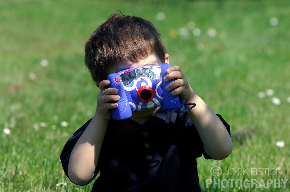 BRUSSELS, BELGIUM - APRIL-25-2007 - A child plays with a digital camera. (PHOTO © JOCK FISTICK)