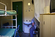 A prisoner demonstraing the cell toilet. Not a nice experience when there are 2 in a cell. HMP & YOI Littlehey. Littlehey is a purpose build category C prison.