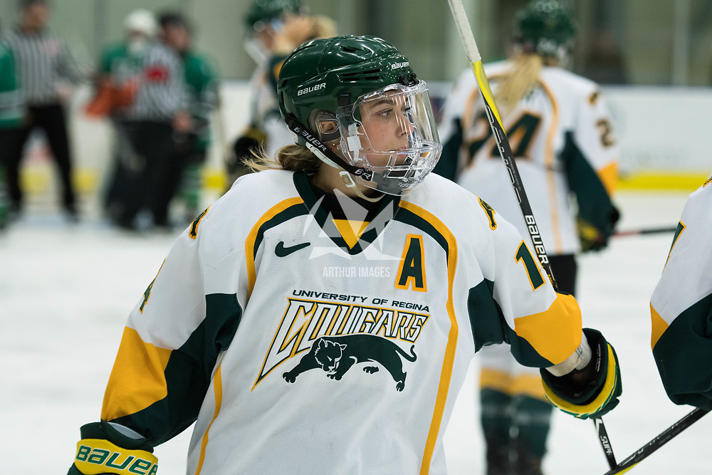 5th year defence man Nikki Watters-Matthes (14) of the Regina Cougars in action during the Women's Hockey Homeopener on October 7 at Co-operators arena. Credit: Arthur Ward/Arthur Images