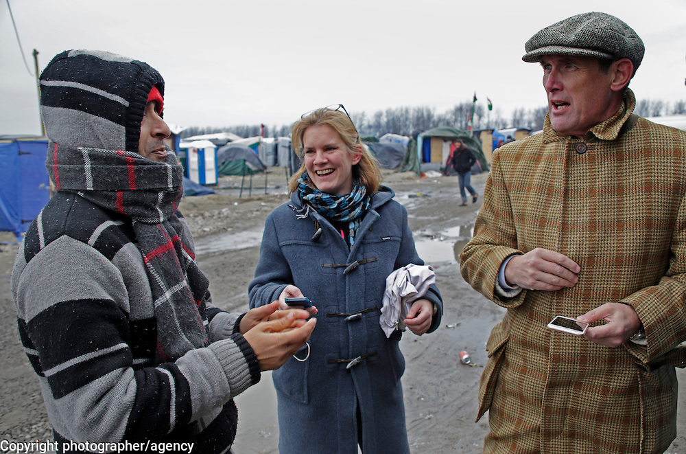 Mohammed (L) from Pakistan, talks with MSF docotr Natalie Roberts (C) and Sunday Times writer AA Gill in the Jungle refugee camp, Calais, France, 22 January 2016.