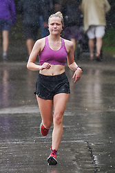 © Licensed to London News Pictures. 27/07/2021. Sheffield, UK. A woman runs during heavy rain in Endcliffe Park, Sheffield. Photo credit: Ioannis Alexopoulos/LNP