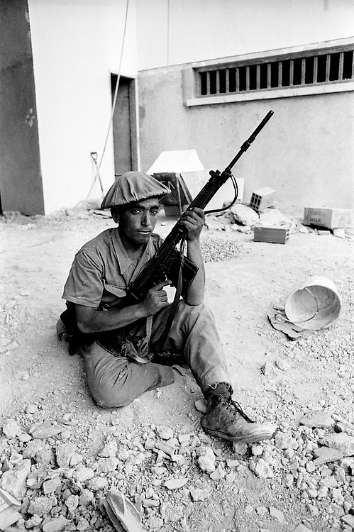 Cyprus War 20 July-18 August 1974. Turkish invasion of Cyprus code-name by Turkey, Operation Attila. A Turkish soldier stands guard over British and German holiday makers after the Turks captured them during the invasion, Cyprus July 1974. Photo by Terry Fincher.