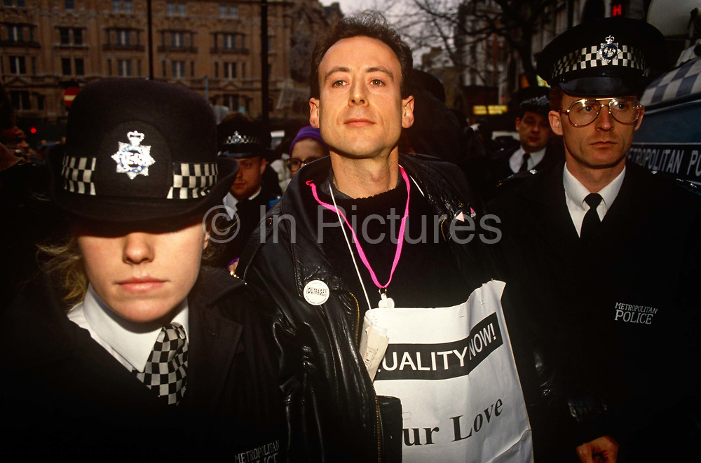 The gay and human rights activist Peter Tatchell is arrested by Met police officers at a protest in central London. Peter Tatchell has been campaigning for human rights, democracy, LGBT freedom and global justice since 1967. He is a member of the queer human rights group OutRage!, and the left-wing of the Green Party. Peter is also the Green Party's spokesperson on human rights. Through the Peter Tatchell Foundation, he campaigns for human rights in Britain and internationally. Source http://www.petertatchell.net
