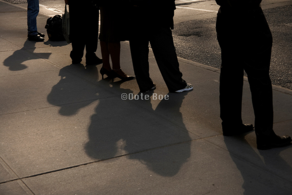 line of business people waiting for the bus to arrive