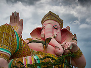 31 AUGUST 2014 - SARIKA, NAKHON NAYOK, THAILAND: A statue of Ganesh dominates Shri Utthayan Ganesha Temple in Sarika, Nakhon Nayok. Ganesh Chaturthi, also known as Vinayaka Chaturthi, is a Hindu festival dedicated to Lord Ganesh. It is a 10-day festival marking the birthday of Ganesh, who is widely worshiped for his auspicious beginnings. Ganesh is the patron of arts and sciences, the deity of intellect and wisdom -- identified by his elephant head. The holiday is celebrated for 10 days, in 2014, most Hindu temples will submerge their Ganesh shrines and deities on September 7. Wat Utthaya Ganesh in Nakhon Nayok province, is a Buddhist temple that venerates Ganesh, who is popular with Thai Buddhists. The temple draws both Buddhists and Hindus and celebrates the Ganesh holiday a week ahead of most other places.    PHOTO BY JACK KURTZ