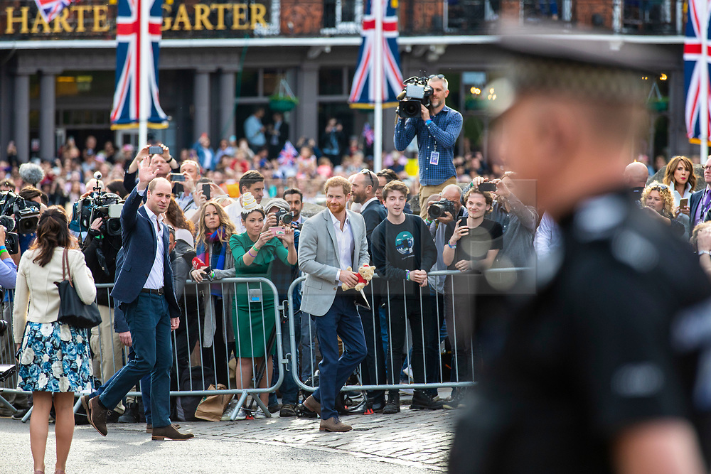 © Licensed to London News Pictures. 18/05/2018. London, UK. Prince Harry and Prince William greet the public outside Windsor Castle on the eve of the Royal Wedding.  Prince Harry and Meghan Markle are to be married in Windsor tomorrow, Saturday 19 May 2018. Photo credit: Rob Pinney/LNP