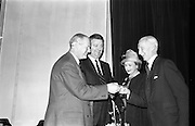 28/03/1963<br /> 03/28/1963<br /> 28 March 1963<br /> Royal Horticultural Society of Ireland Presentation of Gold medals for Rose growing. The Right Honorable Earl of Rosse, President of the Royal Horticultural Society of Ireland(left) presents the Society's special gold medials for Rose growing to Mr. Alex Dixon, Newtownards, (right) and Mr. Sam McGredy at the Royal Horticultural Society 16 St. Stephen's Green, Dublin. also present is the Countess of Rosse.