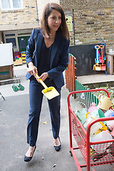 © Licensed to London News Pictures. 08/09/2015. London, UK. Labour party leadership candidate, LIZ KENDALL MP picks up a spade to go to the sandpit during her visit to Clapham Manor Children's Centre in south west London. Photo credit : Vickie Flores/LNP