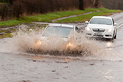 © Licensed to London News Pictures. 24/02/2020. Leek, Staffordshire, UK. Motorists negotiate a flooded section of road on the A53 near Leek in Staffordshire. Photo credit: Graham M. Lawrence/LNP