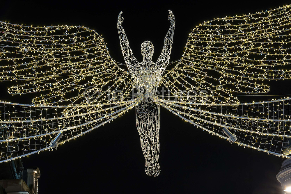 The Spirit of Christmas festive light decorations on Regent Street Saint Jamess at Piccadilly on the 31st December 2019 in London in the United Kingdom.