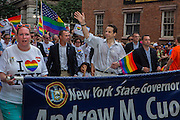 New York Governor Andrew Cuomo waves to the crowd on Christopher Street. Cuomo has many supporters in the gay commuity, having pushed through the legalization of gay marriage in New York in 2011.