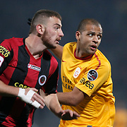 Genclerbirligi's Aykut Demir (L) and Galatasaray's Felipe Melo (R) during their Turkish Superleague soccer match Genclerbirligi between Galatasaray at the 19 Mayis stadium in Ankara Turkey on Saturday 03 December 2011. Photo by TURKPIX