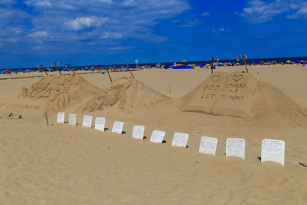 Ocean City, MD - July 10, 2016: A faith inspired sculpture in the sand on the beach near the boardwalk in Ocean City Maryland.