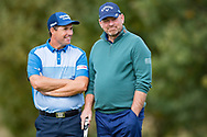 Padraig Harrington of Ireland (left) talks and smiles with Thomas Bjorn of Denmark during the British Masters 2018 at Walton Heath Golf Course, Walton On the Hill, Surrey on 12 October 2018. Picture by Martin Cole.