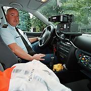 Ad Meester politie Huizen buro verkeershandhaving in de radarauto