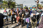 """03 DECEMBER 2013 - BANGKOK, THAILAND:  Thai anti-government protestors enter the government security perimeter in the Dusit district of Bangkok. Thousands of anti-government protestors entered the government offices in the Dusit district of Bangkok Tuesday after police stopped using tear gas and water cannons on the protestors. Protestors marched through the district waving Thai flags and chanting """"long live the King!"""" Suthep Thaugsuban, leader of the protest movement, called it a partial victory but vowed to continue his battle to bring down the government of Yingluck Shinawatra.    PHOTO BY JACK KURTZ"""