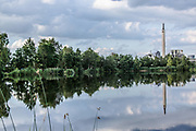 June 30, 2014 - Budel, Noord-Brabant, Netherlands - An industrial chimney reflected in artificial -Ringselven- lake of the Dutch province of Noord-Brabant. (Credit Image: © Vedat Xhymshiti/ZUMA Wire)