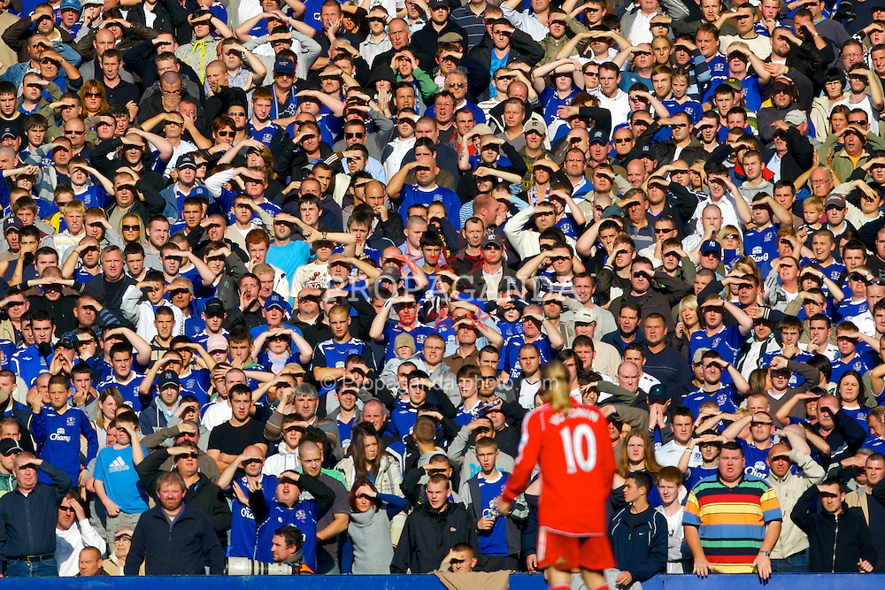 Liverpool, England - Saturday, October 20, 2007: Everton's fans shield their eyes from the late early autumn sunshine during the 206th Merseyside Derby match at Goodison Park. (Photo by David Rawcliffe/Propaganda)