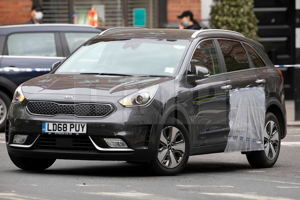 © Licensed to London News Pictures. 03/06/2020. London, UK. An abandoned Kia Niro mini cab has a police evidence bag covering a door panel as it sits on Sloane Square. It is being reported that two people have been injured in the incident. Photo credit: Peter Macdiarmid/LNP