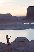 A visitor at West Canyon, Lake Powell, Glen Canyon National Recreation Area, Page, Arizona.  (model released)