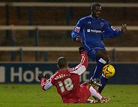 Photo: Daniel Hambury.<br />Peterborough United v Swindon Town. LDV Vans Trophy. 22/11/2005.<br />Swindon's Christian Roberts tackles Peterborough's Calum Willock.