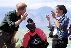 The Duke and Duchess of Sussex with surf mentors during a visit to Waves for Change at Monwabisi Beach in Cape Town, on day two of their tour of Africa.