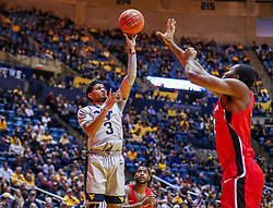 Dec 1, 2018; Morgantown, WV, USA; West Virginia Mountaineers guard James Bolden (3) shoots during the second half against the Youngstown State Penguins at WVU Coliseum. Mandatory Credit: Ben Queen-USA TODAY Sports
