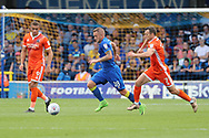 AFC Wimbledon midfielder Dean Parrett (18) dribbling and taking on Shrewsbury Town midfielder Shaun Whalley (7) during the EFL Sky Bet League 1 match between AFC Wimbledon and Shrewsbury Town at the Cherry Red Records Stadium, Kingston, England on 12 August 2017. Photo by Matthew Redman.